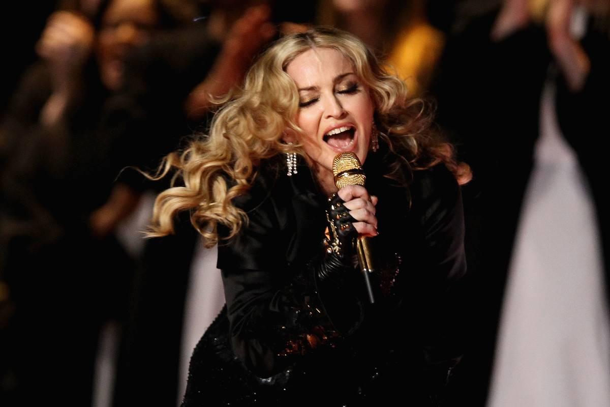 Madonna sings onstage.