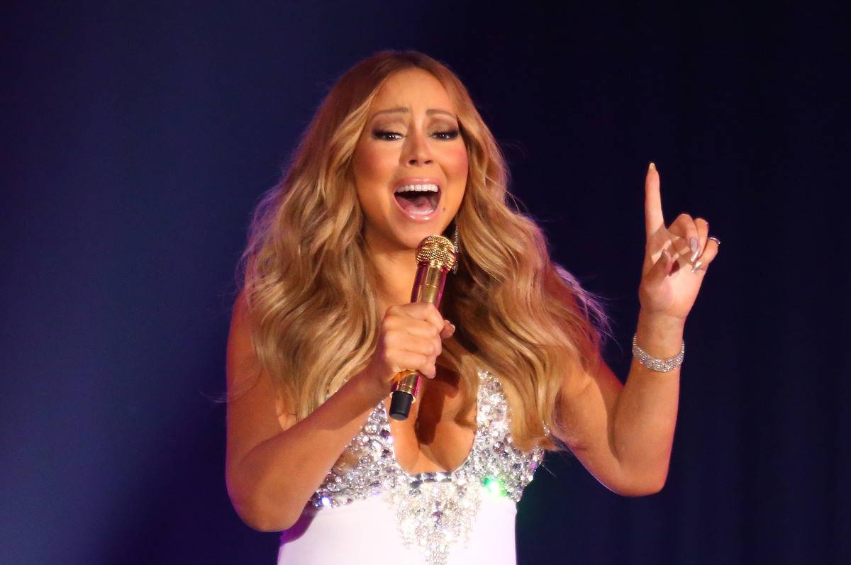 Mariah Carey sings on stage at a casino.