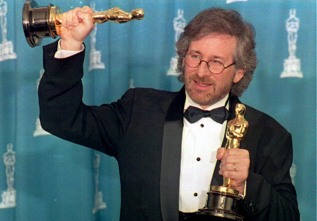 Director Steven Spielberg poses with his two Oscar trophies.