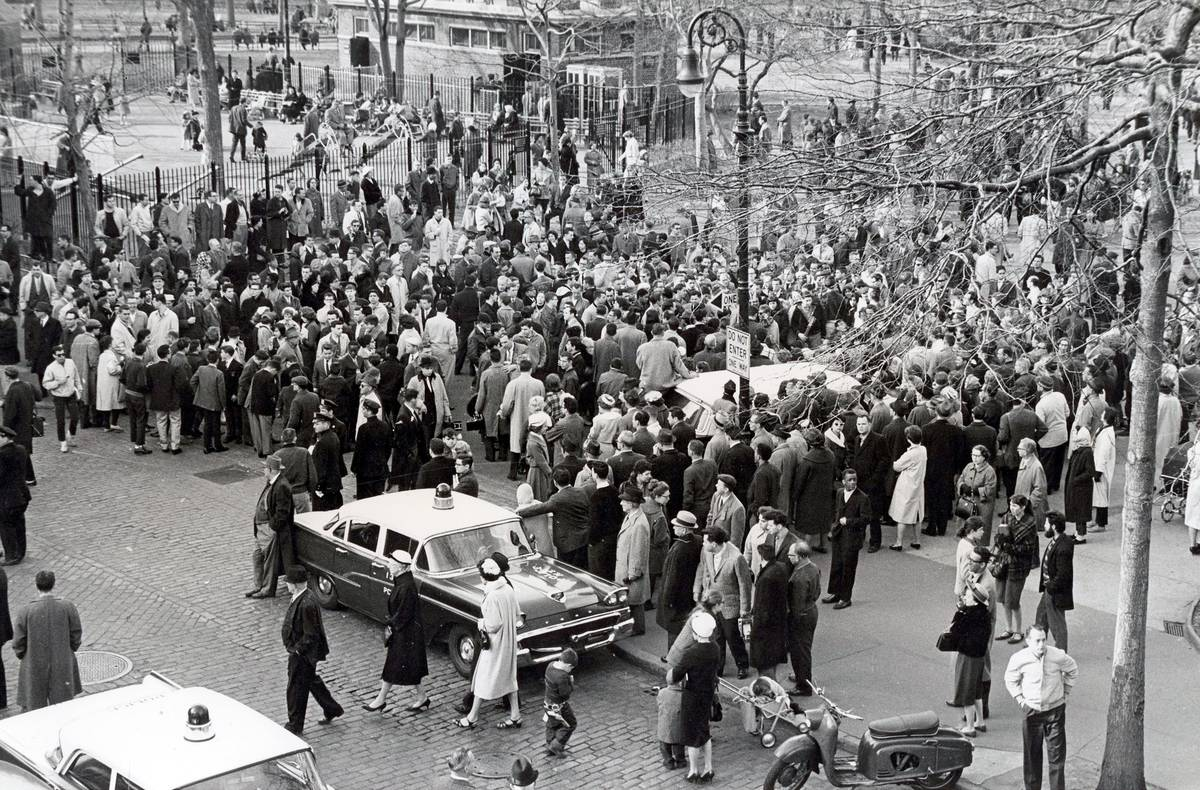 A crowd protests ban on folk music in Washington Square Park in 1961