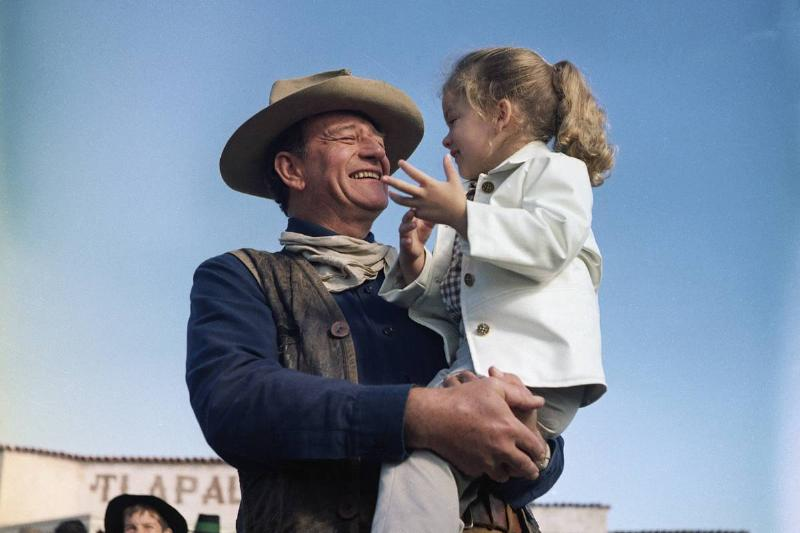 John Wayne and Daughter Aissa on Movie Set