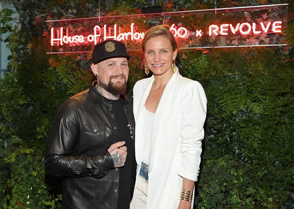 Guitarist Benji Madden and actress Cameron Diaz posing for a photo