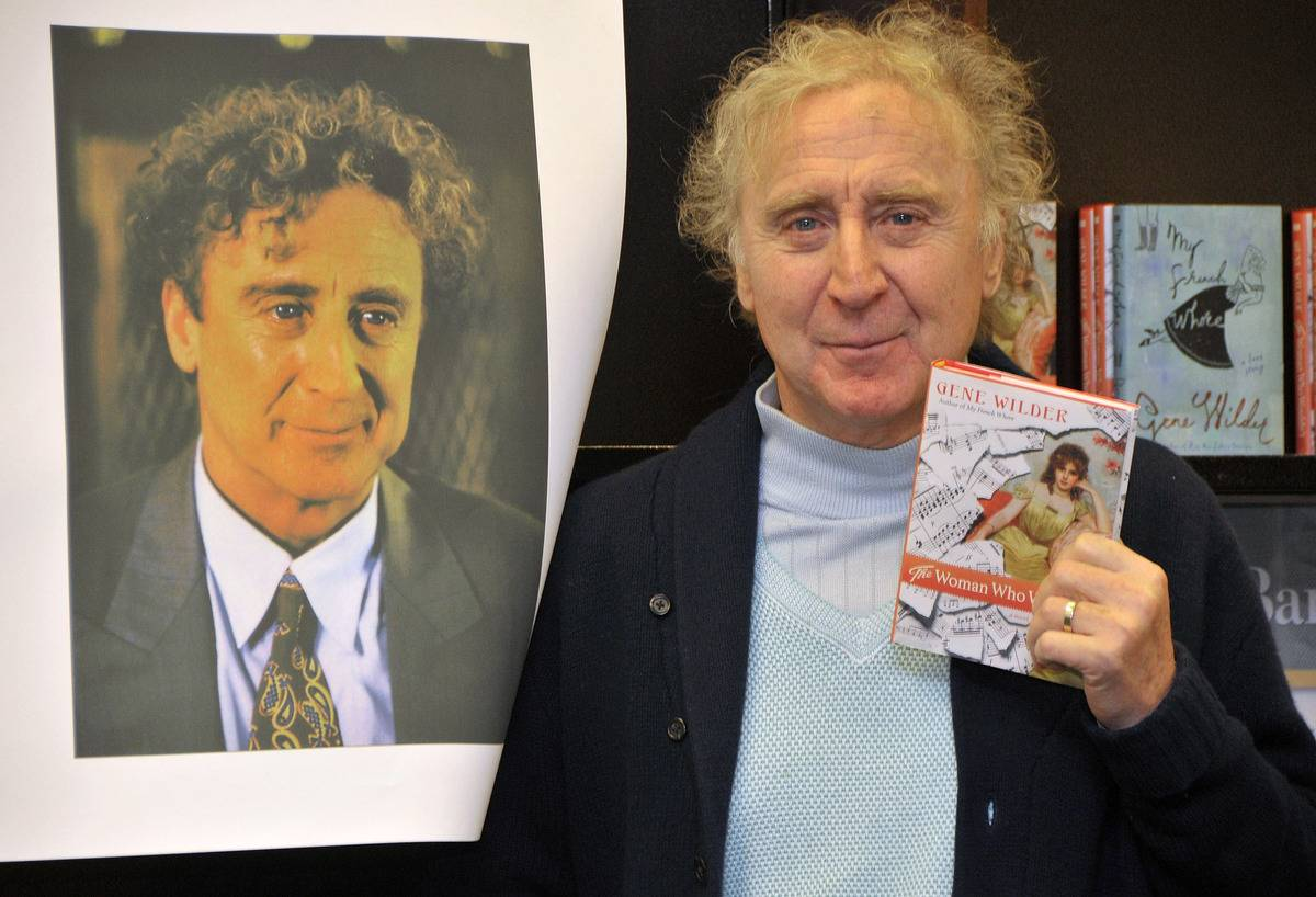 Gene Wilder posing with one of his three novels