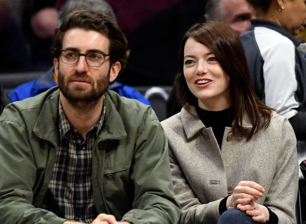 Emma Stone and Dave McCary attending a basketball game in 2019