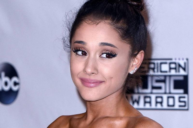 Ariana Grande poses in the press room during the 2015 American Music Awards.