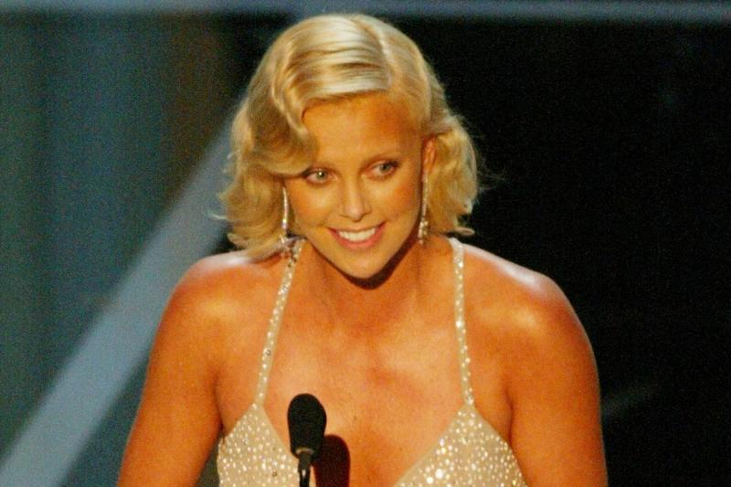 Actress Charlize Theron accepts her award for Best Performance by an Actress, 2004.