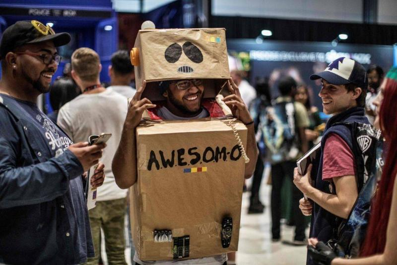 A cosplayer dressed as the cartoon character Awesom-O from the South Park series