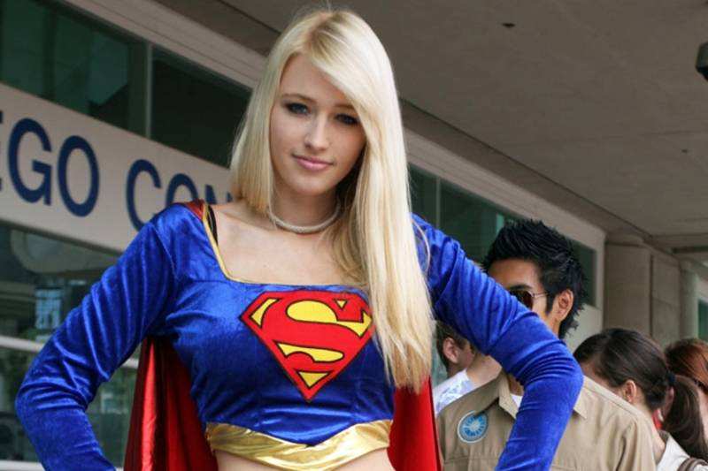 girl dressed as supergirl
