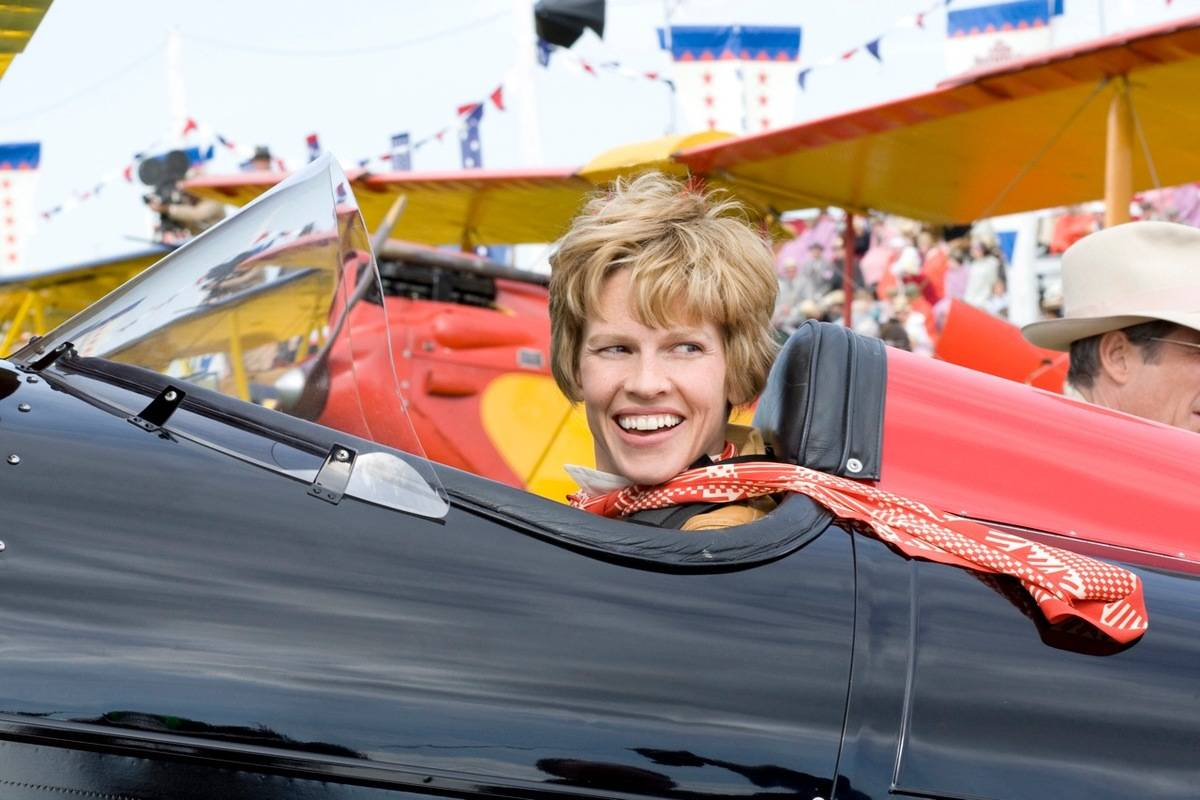 Hilary Swank, portraying Amerlia Earhart, sits in a plane during the 2009 movie.