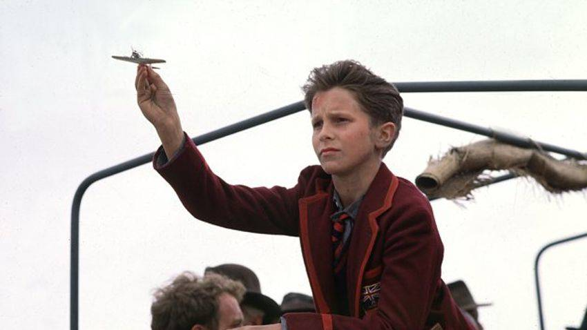 In the movie Empire of the Sun, main character Jamie Graham flies a toy plane.