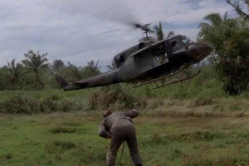 A helicopter lands in front of a soldier in the movie Bat*21.