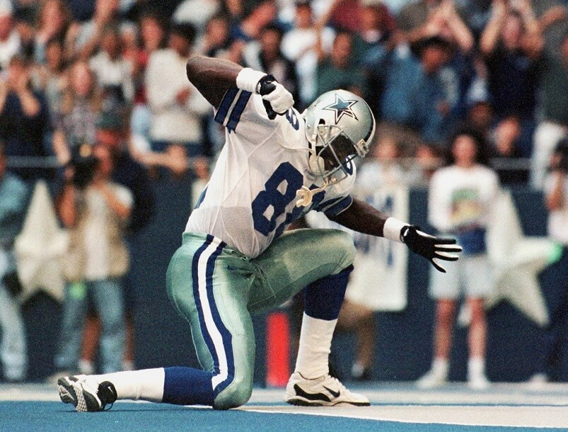 Michael Irvin makes a stabbing motion after a touchdown