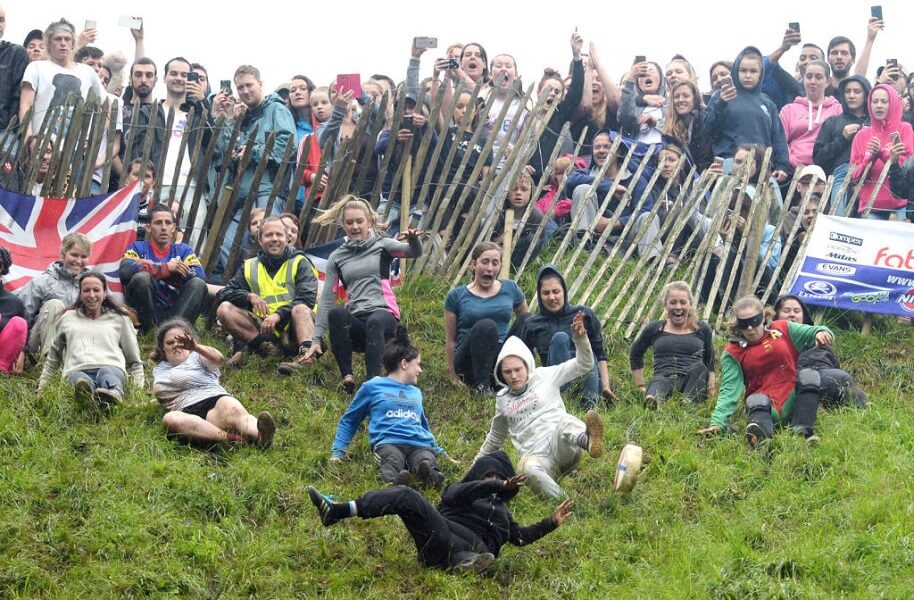 Cheese rolling features people chasing cheese down a hill