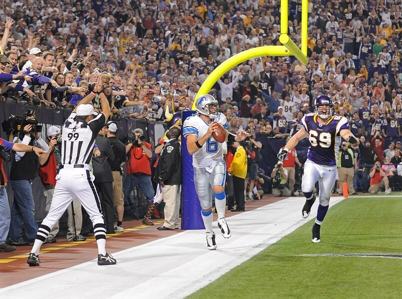 Dan Orlovsky runs out the back of the endzone for a safety